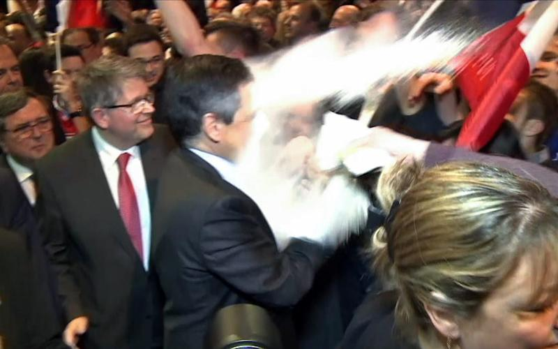 A man throws flour on French presidential candidate Francois Fillon - Credit: JULIEN SENGEL/AFP
