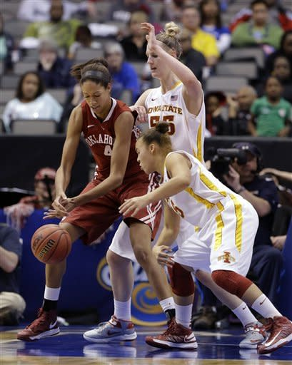 Oklahoma's Nicole Griffin (4) loses control of the ball as Iowa State's Nicole Blaskowsky, front, and Anna Prins, rear, combine to cause the turnover in the second half of an NCAA college basketball game in the Big 12 women's tournament Sunday, March 10, 2013, in Dallas. Iowa State won79-60. (AP Photo/Tony Gutierrez)