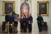 Personal attorney to President Donald Trump, Jay Sekulow, center, talks to reporters outside the Senate chamber, during the impeachment trial against President Donald Trump in the Senate at the U.S. Capitol in Washington,(AP Photo/Steve Helber)