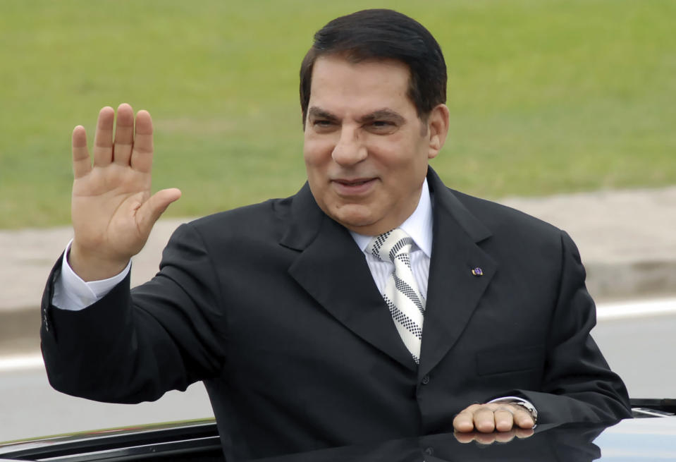 FILE - In this Oct.11, 2009 file photo, then Tunisian President Zine El Abidine Ben Ali waves from his car at a campaign rally in Rades, outside Tunis. On Thursday Jan. 14, 2021, Tunisia commemorates 10-years since the flight into exile of its iron-fisted leader, Zine El Abidine Ben Ali, pushed from power in a popular revolt that foreshadowed the so-called Arab Spring, but without festive celebrations because of the coronavirus lockdown. (AP Photo/Hassene Dridi, File)