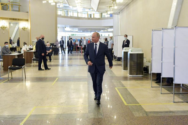 Russian President Vladimir Putin arrives to take part in voting at a polling station in Moscow, Russia, Wednesday, July 1, 2020. The vote on the constitutional amendments that would reset the clock on Russian President Vladimir Putin's tenure and enable him to serve two more six-year terms is set to wrap up Wednesday. (Alexei Druzhinin, Sputnik, Kremlin Pool Photo via AP)