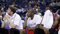 Philadelphia 76ers players watch from the bench in the closing seconds of a 123-80 loss to the Golden State Warriors during the second half of an NBA basketball game on Monday, Feb. 10, 2014, in Oakland, Calif. (AP Photo/Marcio Jose Sanchez)