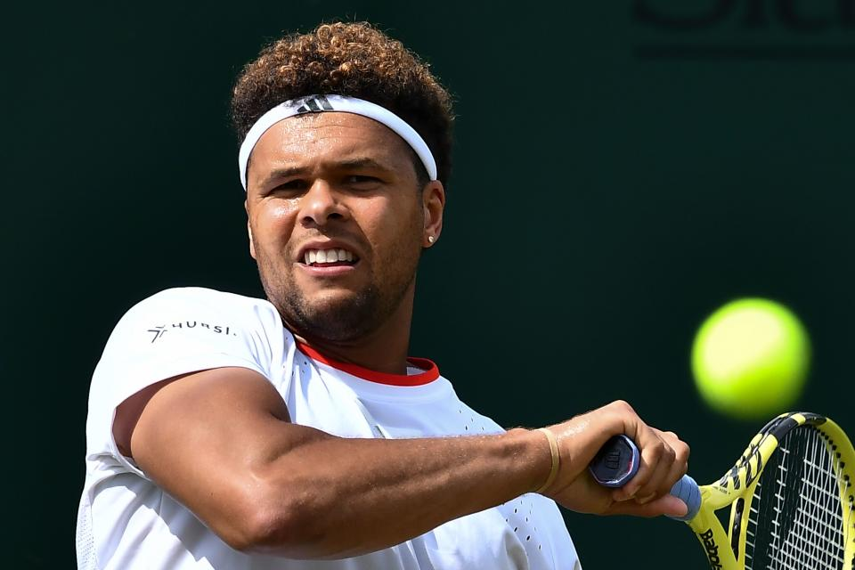 France's Jo-Wilfried Tsonga returns against Australia's Bernard Tomic during their men's singles first round match on the second day of the 2019 Wimbledon Championships at The All England Lawn Tennis Club in Wimbledon, southwest London, on July 2, 2019. (Photo by Ben Stansall/AFP/Getty Images)