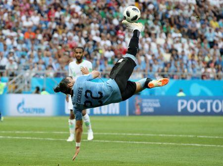 Soccer Football - World Cup - Group A - Uruguay vs Saudi Arabia - Rostov Arena, Rostov-on-Don, Russia - June 20, 2018 Uruguay's Martin Caceres shoots at goal with an overhead kick REUTERS/Marko Djurica