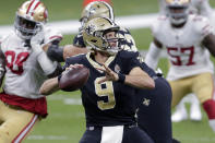New Orleans Saints quarterback Drew Brees (9) passes in the first half of an NFL football game against the San Francisco 49ers in New Orleans, Sunday, Nov. 15, 2020. (AP Photo/Brett Duke)