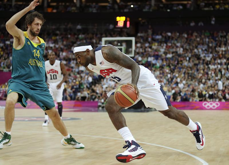 USA's Lebron James, right, drive to the basket against Australia's Matt Nielsen during a men's quarterfinals basketball game at the 2012 Summer Olympics, Wednesday, Aug. 8, 2012, in London. (AP Photo/Charles Krupa)