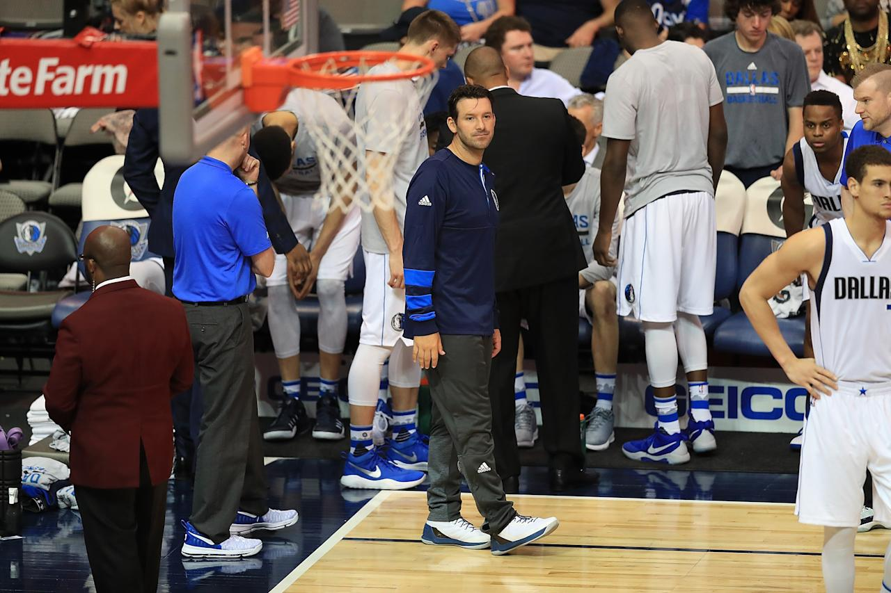 DALLAS, TX - APRIL 11:  Former NFL quarterback Tony Romo #9 of the Dallas Cowboys on the bench with the Dallas Mavericks during a game against the Denver Nuggets at American Airlines Center on April 11, 2017 in Dallas, Texas.  NOTE TO USER: User expressly acknowledges and agrees that, by downloading and/or using this photograph, user is consenting to the terms and conditions of the Getty Images License Agreement.  (Photo by Ronald Martinez/Getty Images)
