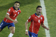 Chile's Mauricio Isla, right, celebrates after scoring against Uruguay with teammate Chile's Alexis Sanchez, left, during a Copa America quarterfinal soccer match at the National Stadium in Santiago, Chile, Wednesday, June 24, 2015. (AP Photo/Silvia Izquierdo)