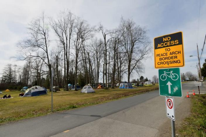 FILE PHOTO: Canadians and Americans meet on the border south of Vancouver
