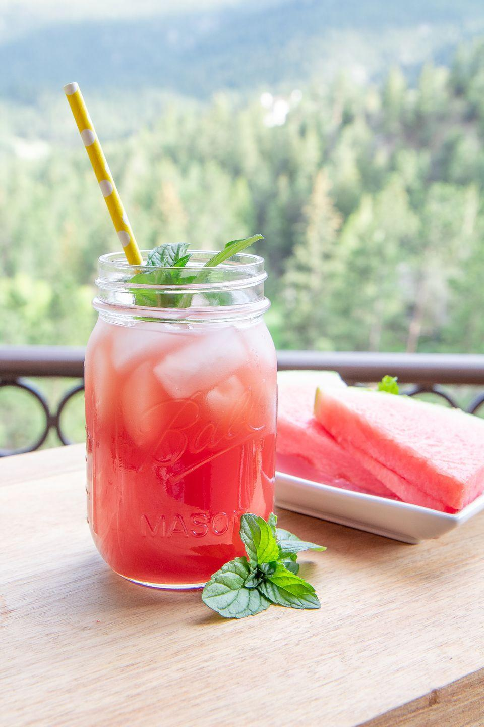 """<p>Put a twist on your summer iced tea with this mint and watermelon drink. Enjoy it while relaxing in the sun!</p><p><strong>Get the recipe at <a href=""""https://everydaylaura.com/2020/06/20/watermelon-mint-iced-tea/"""" rel=""""nofollow noopener"""" target=""""_blank"""" data-ylk=""""slk:Everyday Laura"""" class=""""link rapid-noclick-resp"""">Everyday Laura</a>. </strong></p><p><strong><a class=""""link rapid-noclick-resp"""" href=""""https://go.redirectingat.com?id=74968X1596630&url=https%3A%2F%2Fwww.walmart.com%2Fsearch%2F%3Fquery%3Dmason%2Bjars&sref=https%3A%2F%2Fwww.thepioneerwoman.com%2Ffood-cooking%2Fmeals-menus%2Fg32147587%2Fwatermelon-drink-recipes%2F"""" rel=""""nofollow noopener"""" target=""""_blank"""" data-ylk=""""slk:SHOP MASON JARS"""">SHOP MASON JARS</a><br></strong></p>"""