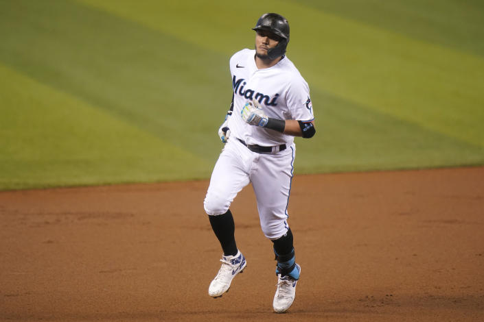 Miami Marlins' Miguel Rojas rounds the bases after hitting a solo home run during the first inning of a baseball game against the Arizona Diamondbacks, Thursday, May 6, 2021, in Miami. (AP Photo/Lynne Sladky)