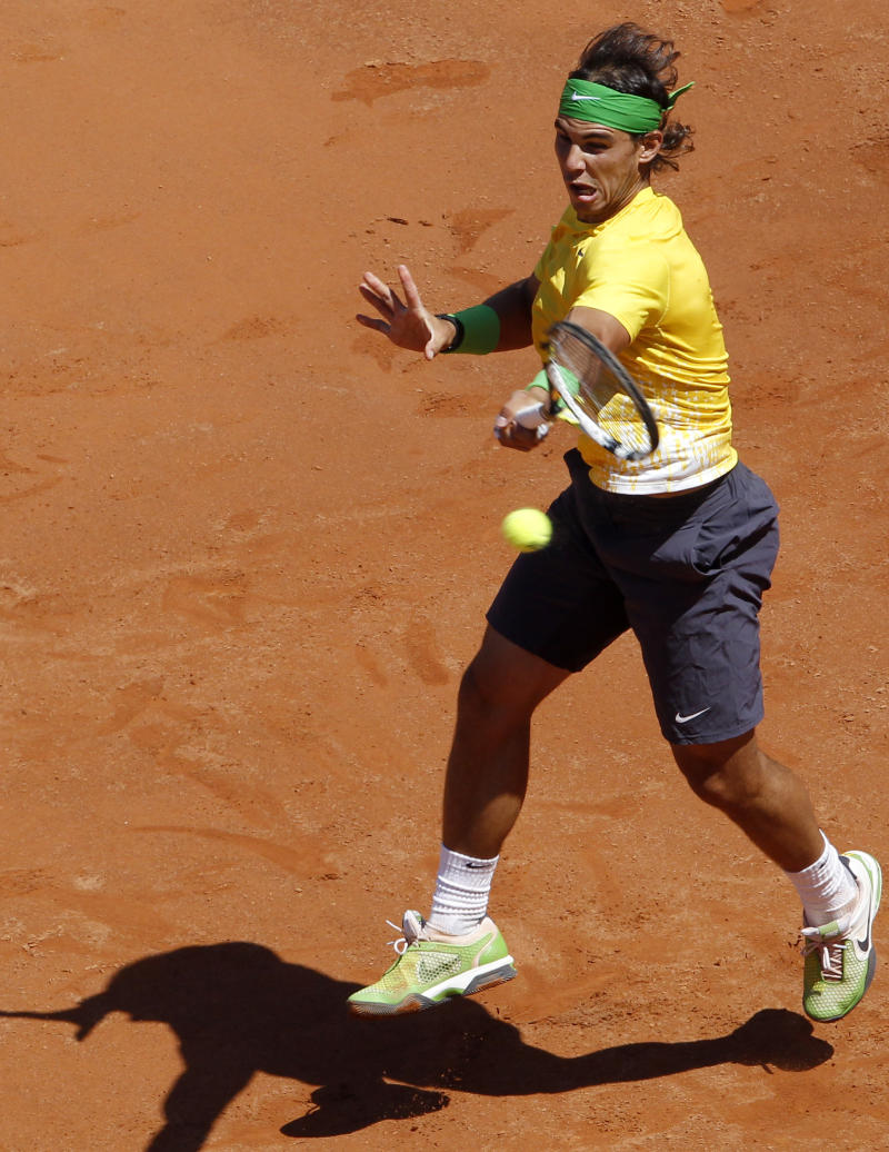 Spain's Rafael Nadal returns the ball to France's Richard Gasquet during their semifinal match at the Italian Open tennis tournament, in Rome, Saturday, May 14, 2011. (AP Photo/Riccardo De Luca)