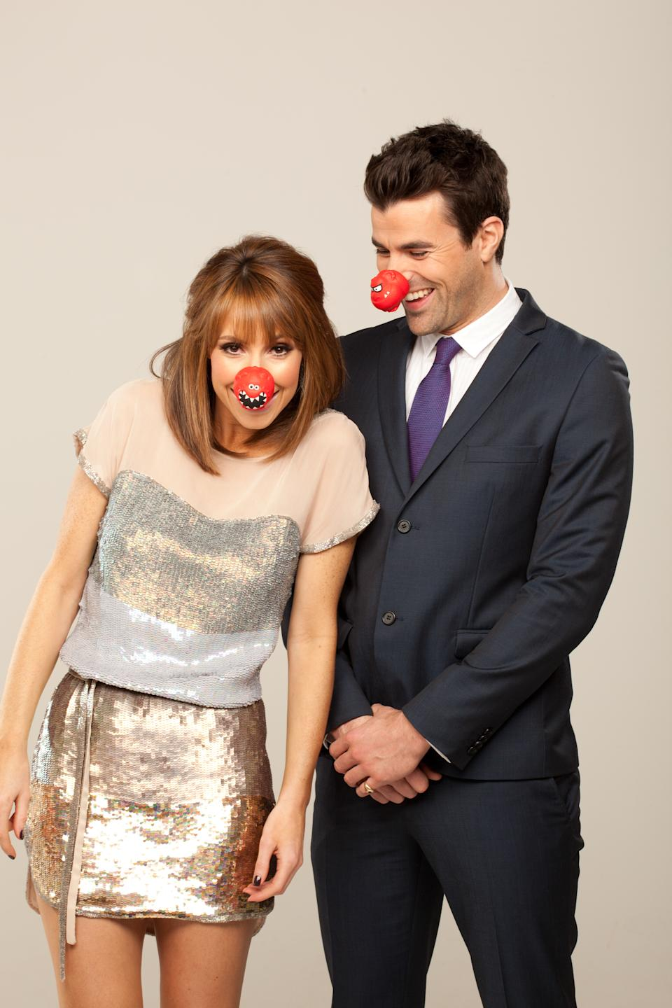 LONDON - DECEMBER 22: Welsh television presenters Steve Jones and Alex Jones, wearing a Red Nose Day 2013 nose and t-shirt for Red Nose Day 2013, in the studio on 22 December, 2012 in London. (Photo by Gary Moyes/Comic Relief/Getty Images)