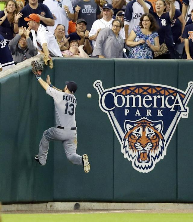 Seattle Mariners left fielder Dustin Ackley goes after a foul ball hit by Detroit Tigers' Ian Kinsler during the fifth inning of a baseball game, Friday, Aug. 15, 2014, in Detroit. (AP Photo/Carlos Osorio)