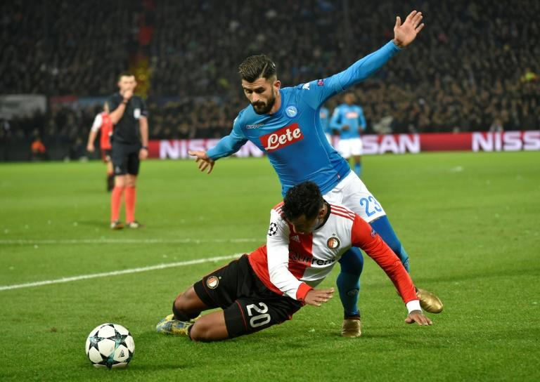 Feyenoord's Renato Tapia (L) vies for the ball with Napoli's Elseid Hysaj during their match at the Feyenoord Stadium in Rotterdam on December 6, 2017