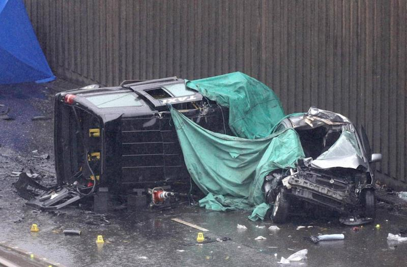 A black cab left on its side following the crash which killed its driver and two passengers (PA)