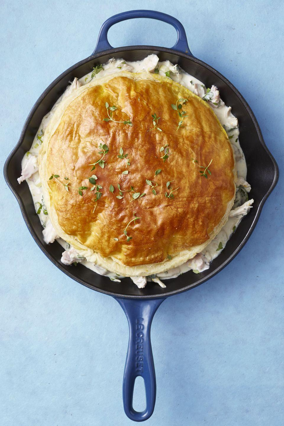 "<p>Chicken pot pie — ahem, we mean<em> turkey</em> pot pie — is a classic at any large family gathering. Serve with a side of greens to make this meal extra hearty.</p><p><em><a href=""https://www.goodhousekeeping.com/food-recipes/easy/a46645/skillet-turkey-pot-pie-recipe/"" rel=""nofollow noopener"" target=""_blank"" data-ylk=""slk:Get the recipe for Skillet Turkey Pot Pie »"" class=""link rapid-noclick-resp"">Get the recipe for Skillet Turkey Pot Pie »</a></em> </p>"