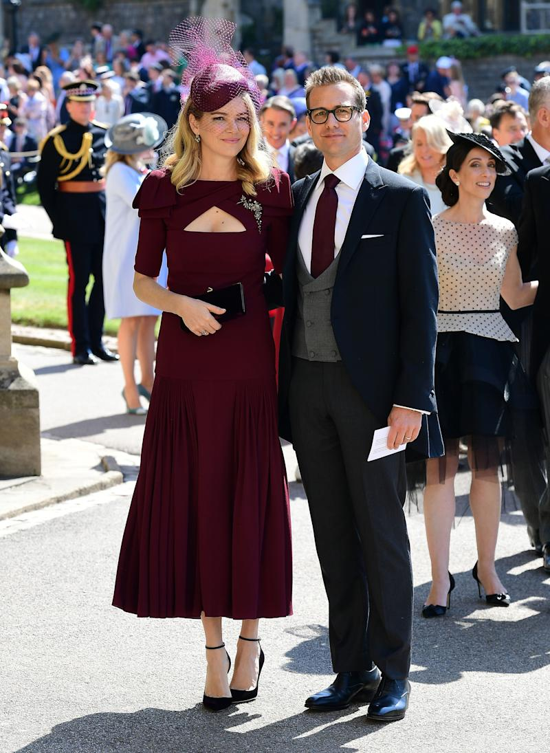 Actor Gabriel Macht and wife Jacinda Barrett arrive at St George's Chapel at Windsor Castle before the wedding of Prince Harry to Meghan Markle on May 19, 2018 in Windsor, England.