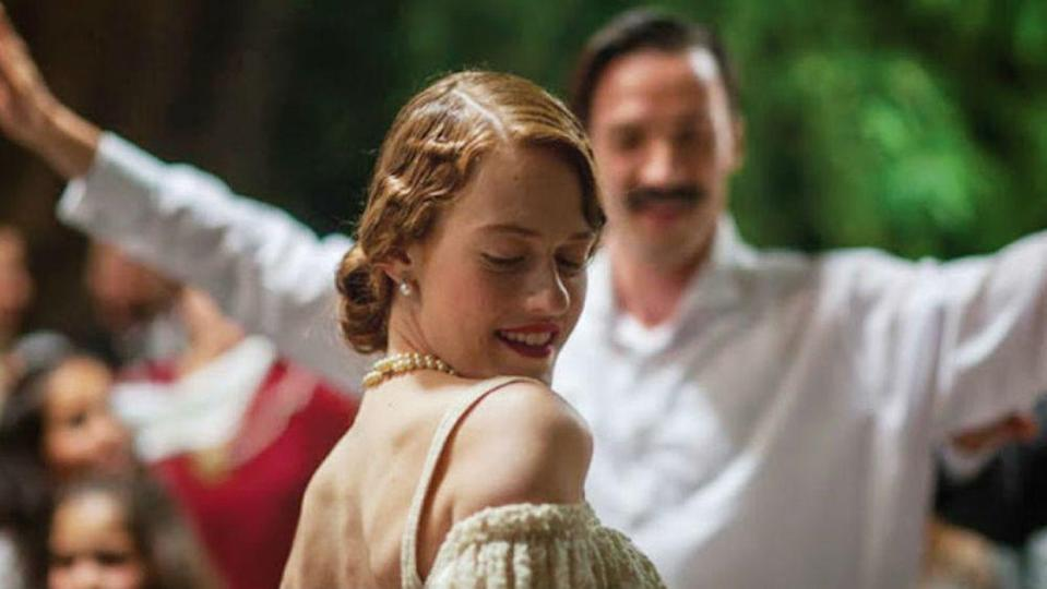 """<p><em>Little England </em>is an old-fashioned romantic drama, in that it's sweeping, epic, and will have you hanging on to every last plot twist. Orsa (Pinelopi Tsilika) and Moscha (Sofia Kokkali) are sisters living on the windswept island of Andros in the 1930s. It's a place where men are gone sailing for most of the year, leaving women to dream of romance—or escape. Their mother is set on marrying them off, and doesn't take their desires into consideration. What results is a gut-wrenching tale of forbidden love, within a family. <br></p><p><a class=""""link rapid-noclick-resp"""" href=""""https://www.amazon.com/Little-England-Penelope-Tsilika/dp/B07DYDBR13/?tag=syn-yahoo-20&ascsubtag=%5Bartid%7C10072.g.33383086%5Bsrc%7Cyahoo-us"""" rel=""""nofollow noopener"""" target=""""_blank"""" data-ylk=""""slk:Watch Now"""">Watch Now</a></p>"""