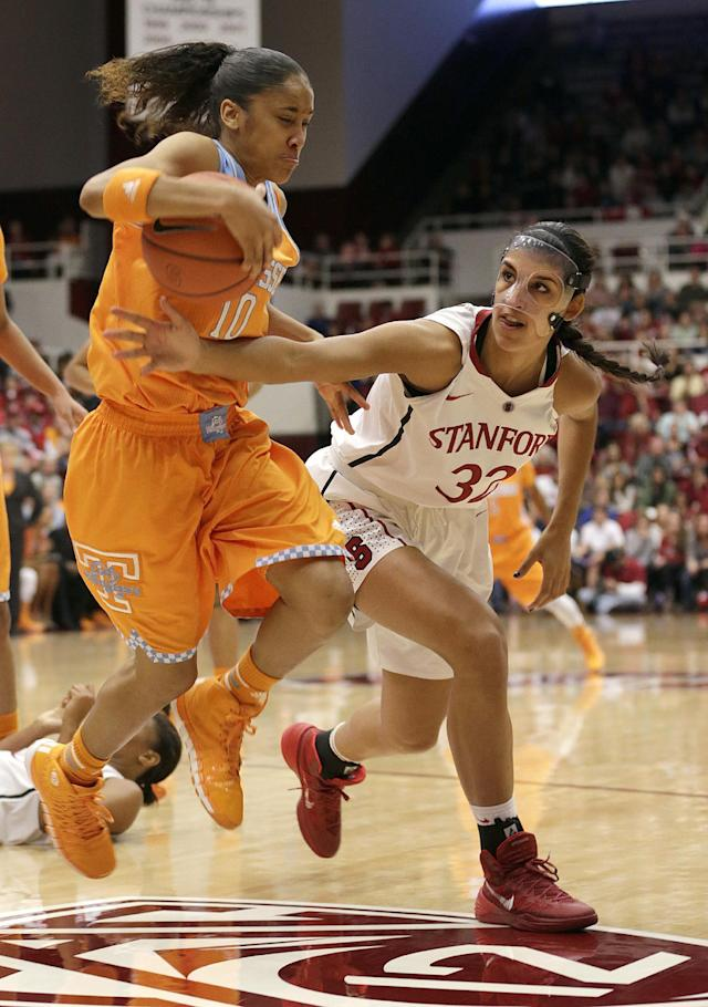 Tennessee guard Meighan Simmons (10) battles for the loose ball against Stanford forward Kailee Johnson (32) during the first half of an NCAA women's college basketball game, Saturday, Dec. 21, 2013, in Stanford, Calif. (AP Photo/Tony Avelar)