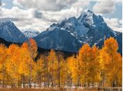 """<p>Visit Grand Teton <a href=""""https://www.purewow.com/travel/best-national-parks-in-america"""" rel=""""nofollow noopener"""" target=""""_blank"""" data-ylk=""""slk:National Par"""" class=""""link rapid-noclick-resp"""">National Par</a><a href=""""https://www.purewow.com/travel/best-national-parks-in-america"""" rel=""""nofollow noopener"""" target=""""_blank"""" data-ylk=""""slk:k"""" class=""""link rapid-noclick-resp"""">k</a> during any season and it will punch you in the gut (ya know, in the best way). The park includes the Teton mountain range and Jackson Hole valley.</p>"""