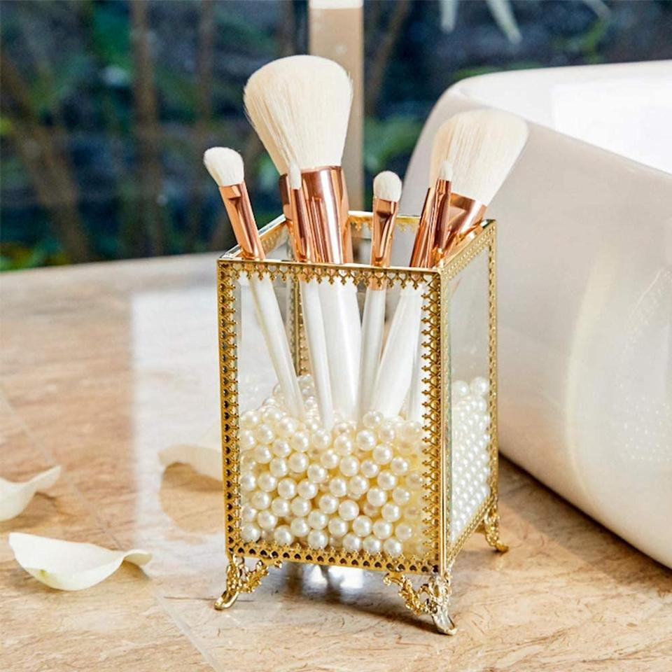 <p>Add a dash of <b>Bridgerton</b> to your vanity decor with the <span>Elegant Handmade Makeup Brush Holder </span> ($38). It even comes with the pearls.</p>