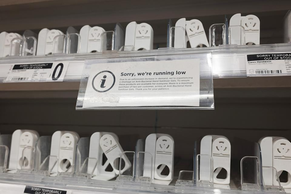 Empty shelves where hand sanitiser is usually stocked inside a London supermarket.