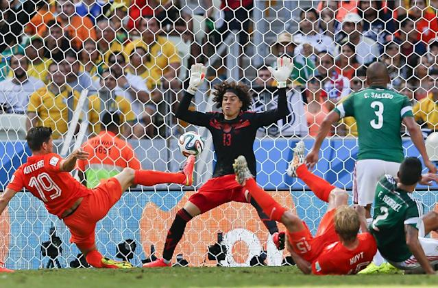 Mexico's goalkeeper Guillermo Ochoa gets ready to block a kick by Netherlands' Klaas-Jan Huntelaar during the World Cup round of 16 soccer match between the Netherlands and Mexico at the Arena Castelao in Fortaleza, Brazil, Sunday, June 29, 2014. (AP Photo/Eduardo Verdugo)