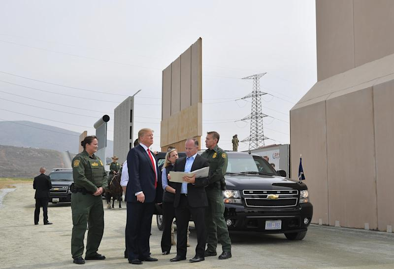 President Donald Trump inspects border wall prototypes in San Diego on March 13.