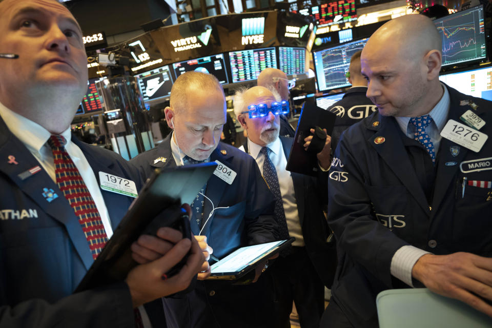 Stock traders work at New York Stock Exchange, Tuesday, Dec. 31, 2019. Stocks slipped globally in quiet New Year's Eve trading Tuesday with many markets closed. Wall Street could close 2019 with back-to-back daily losses in a year that the U.S. posted the largest market gains since 2013. (AP Photo/Mark Lennihan)