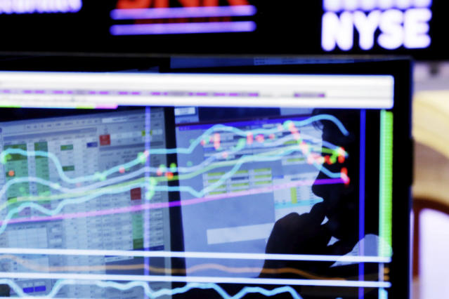 FILE – In this Jan. 11, 2016, file photo, specialist Anthony Rinaldi is silhouetted on a screen at his post on the floor of the New York Stock Exchange. (AP Photo/Richard Drew, File)