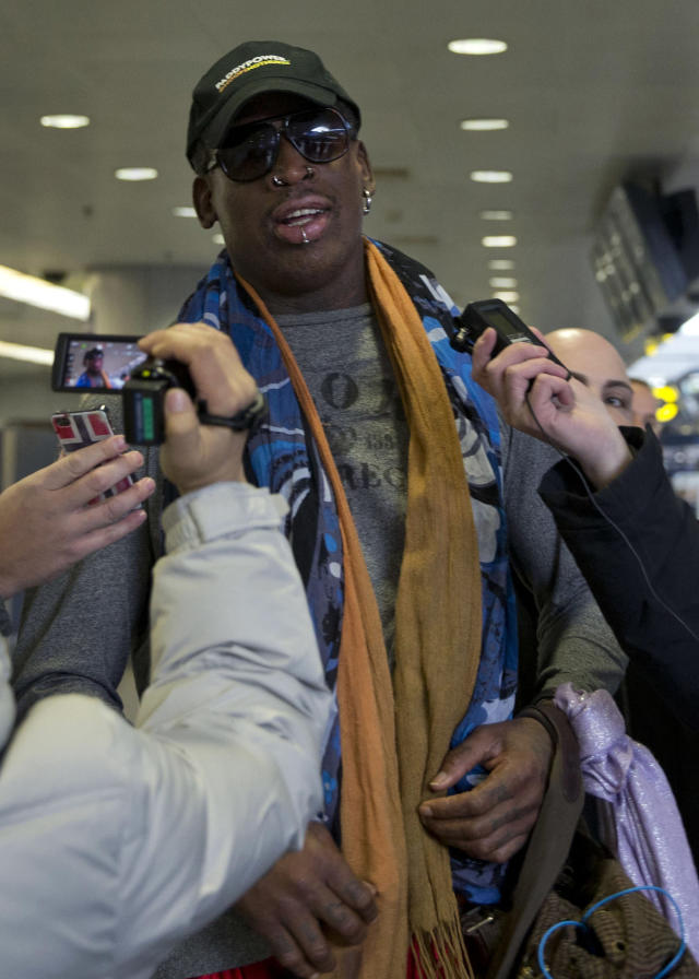 Former NBA star Dennis Rodman arrives at the capital airport for a flight to North Korea, in Beijing, China, Thursday, Dec. 19, 2013. Rodman is flying to North Korea to help train the national team and renew his friendship with the North's young leader Kim Jong Un, a visit unaffected by the recent execution of Kim's uncle in a dramatic political purge. (AP Photo/Ng Han Guan)