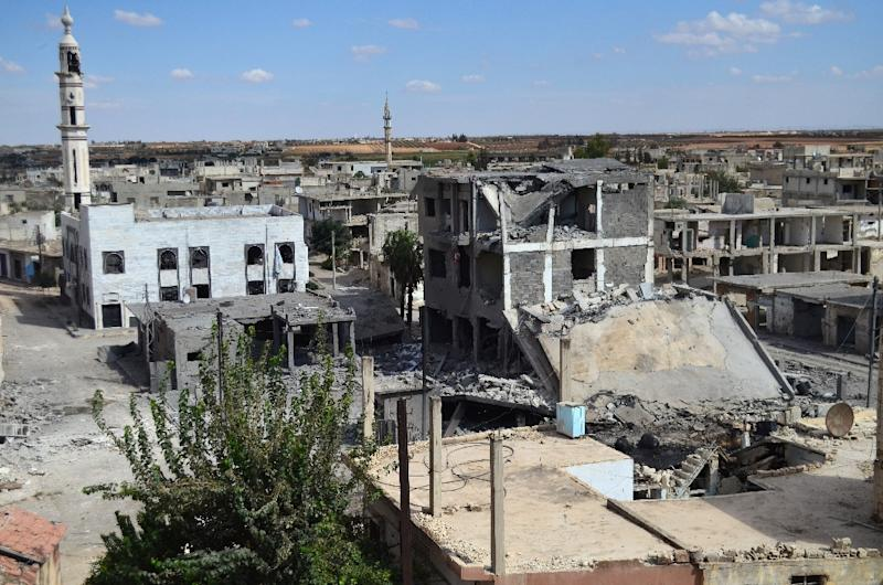 Deserted streets and damaged buildings in the central Syrian town of Talbisseh in the Homs province on September 30, 2015