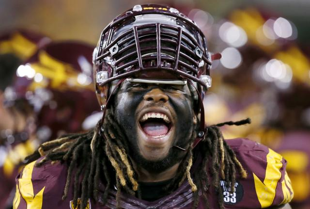 FILE - In this Oct. 12, 2013 file photo, Arizona State's Will Sutton shouts out while on the bench during the second half of an NCAA college football game against Colorado in Tempe, Ariz. Sutton, Alabama linebacker C.J. Mosley, and Arizona running back Ka'Deem Carey have been selected to The Associated Press All-America team for the second straight season, Tuesday, Dec. 17, 2013. (AP Photo/Ross D. Franklin, File)