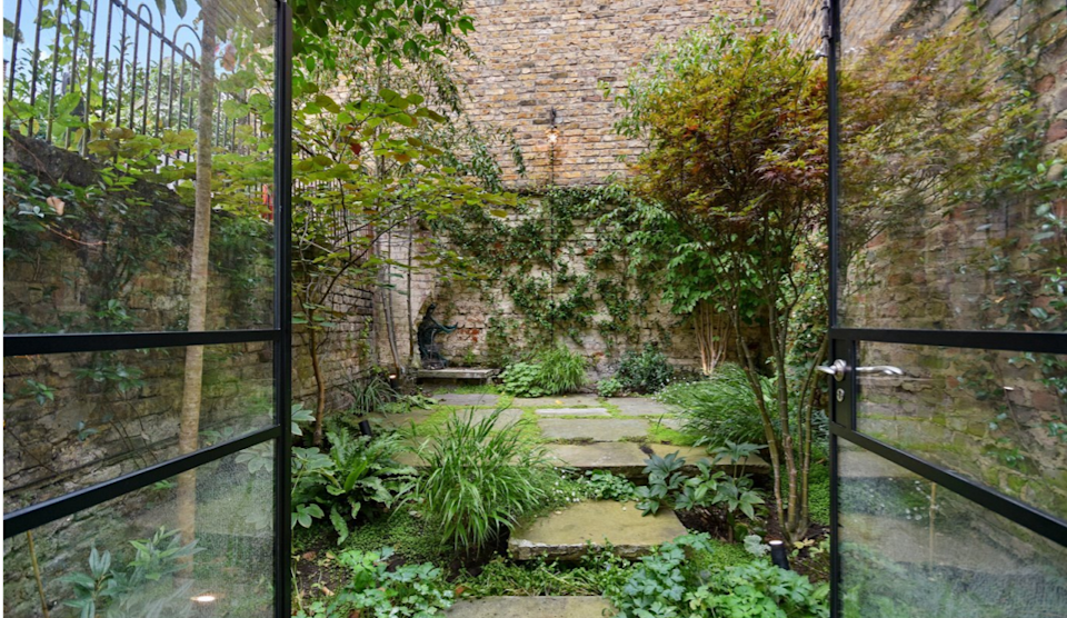 The property boasts a patio garden. Photo: Winkworth