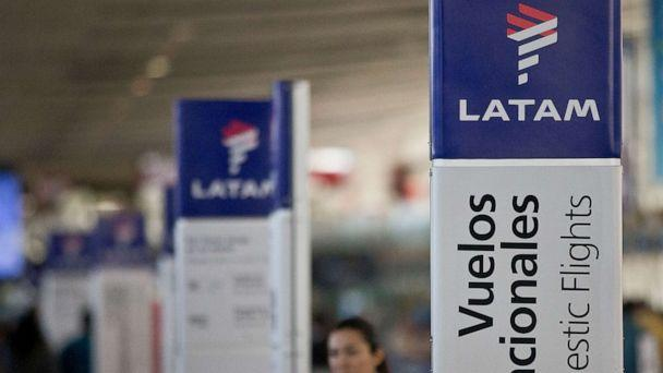 PHOTO: In this file photo taken on July 25, 2016, an agent of LATAM Airlines stands by the counters at the airport in Santiago, Chile. (Esteban Felix/AP)
