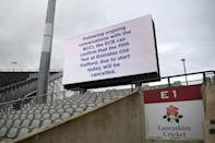 No overs and out: A digital screen displays news of the cancellation of the fifth Test between England and India at Old Trafford (AFP/Oli SCARFF)