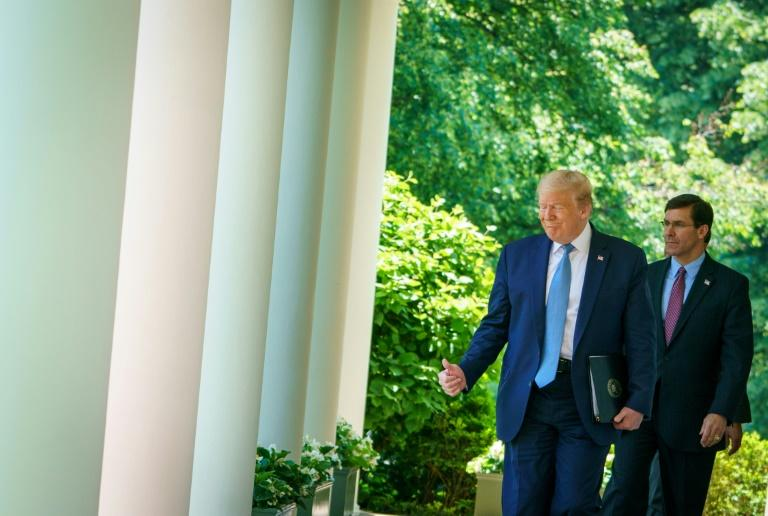 Defense Secretary Mark Esper (R), seen outside the White House with Donald Trump on May 15, 2020, is set to brief the president on plans to shift thousands of troops from Germany