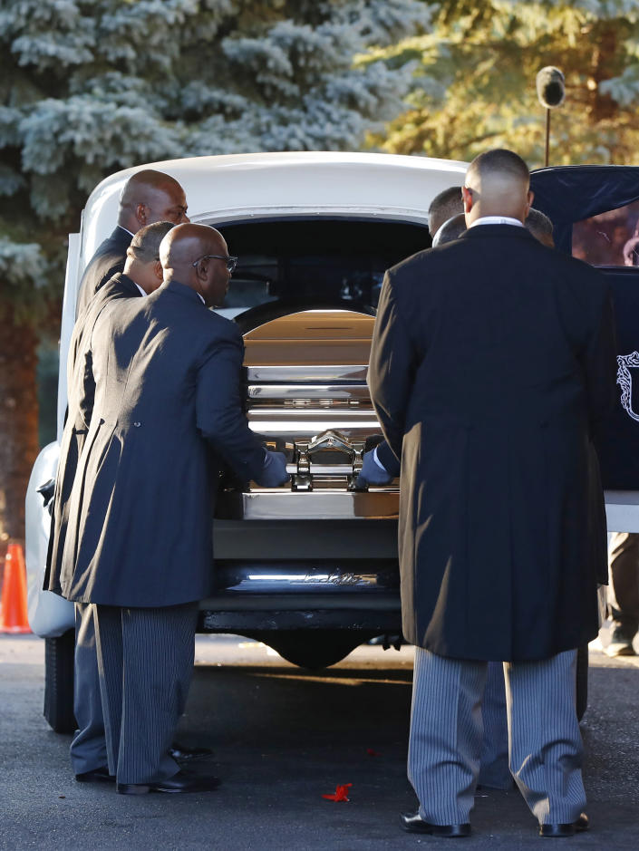 Pallbearers carry the gold casket of legendary singer Aretha Franklin after arriving at the Greater Grace Temple in Detroit, Friday, Aug. 31, 2018. Franklin died Aug. 16 of pancreatic cancer at the age of 76. (AP Photo/Paul Sancya)