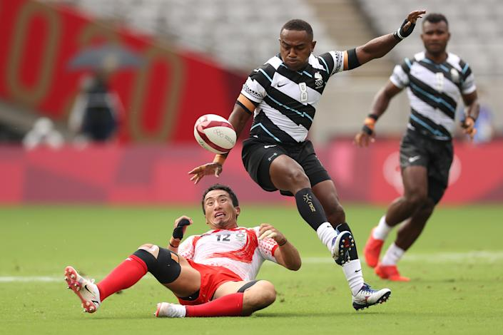 <p>Waisea Nacuqu of Team Fiji wins the ball against Naoki Motomura of Team Japan on day three of the Tokyo 2020 Olympic Games at Tokyo Stadium on July 26, 2021 in Chofu, Tokyo, Japan. (Photo by Dan Mullan/Getty Images)</p>