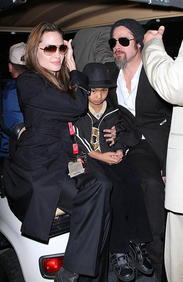 "Angelina Jolie and Brad Pitt took their 8-year-old son Maddox to the game, where they cheered on the New Orleans Saints to victory! Brangelina also did their best to put any breakup rumors to rest by smooching and laughing in their VIP skybox. Alexander Tamargo/<a href=""http://www.gettyimages.com/"" target=""new"">GettyImages.com</a> - February 6, 2010"