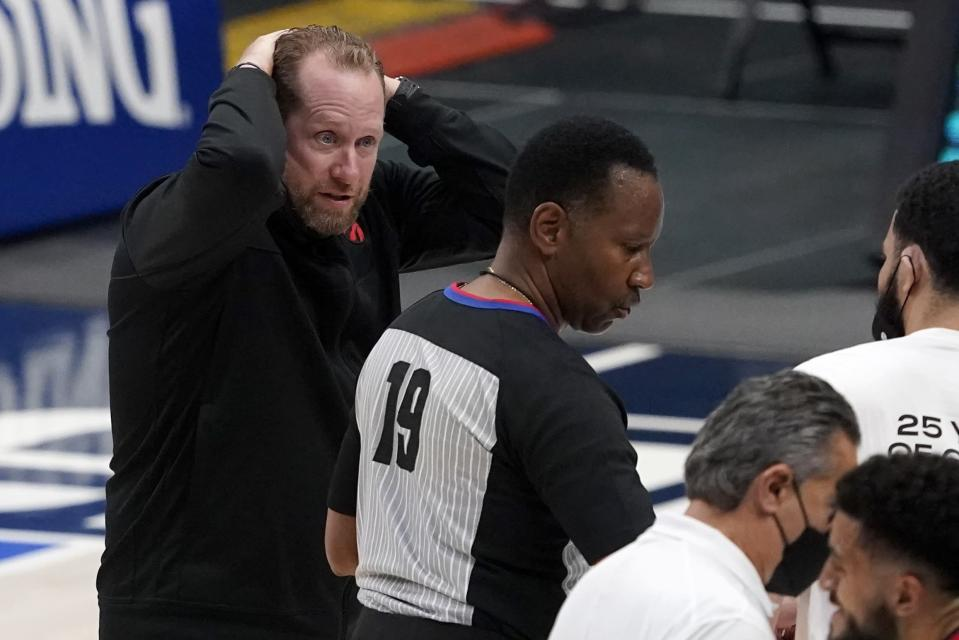 Toronto Raptors head coach Nick Nurse, left, motions his hands to his head in front of referee James Capers (19) after a flagrant call was made against forward Freddie Gillespie in the second half of an NBA basketball game against the Dallas Mavericks in Dallas, Friday, May 14, 2021. (AP Photo/Tony Gutierrez)
