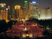 FILE - In this June 4, 2009, file photo, thousands of people attend a candlelight vigil in Hong Kong's Victoria Park to mark the anniversary of the military crackdown on a pro-democracy student movement in Beijing. (AP Photo/Vincent Yu, File)