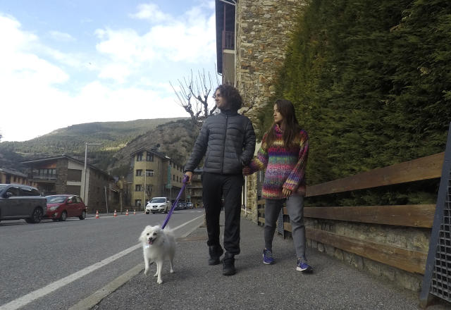 Marco Trungelliti and his wife, Nadir, walk their dog in the principality of Andorra Monday, April 8, 2019. Blowing the whistle on betting-related corruption that is eating at tennis' credibility has come at a cost for the Argentine whose mad-dash road trip to Roland Garros last year caused a sensation. (AP Photo/John Leicester)