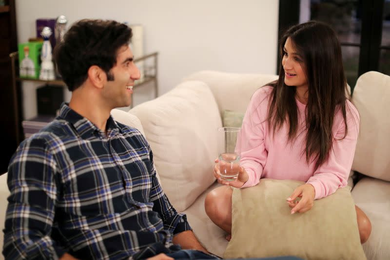 FILE PHOTO: Dr. Zafia Anklesaria, who is seven months pregnant, chats with her husband, Aryan Jafari at home in Los Angeles