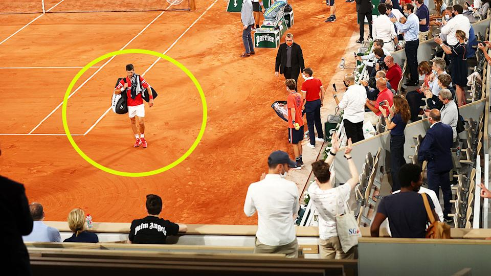 Novak Djokovic, pictured here walking off the court after play was suspended during his quarter-final clash with Matteo Berrettini.