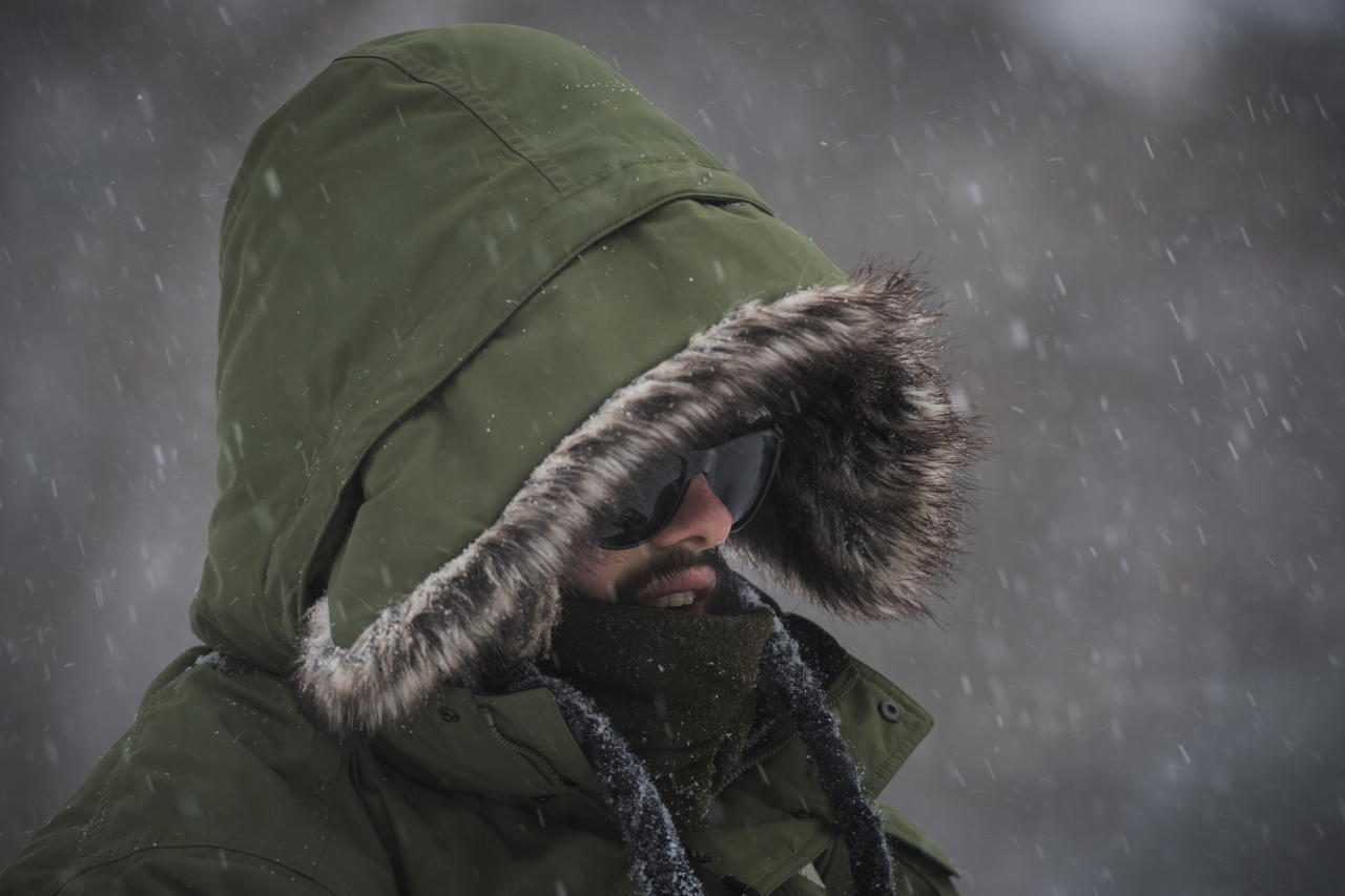 <p>Alano Silva bundles up for the winter storm while spending the early afternoon at High Park in Toronto on February 12, 2019. THE CANADIAN PRESS/ Tijana Martin </p>