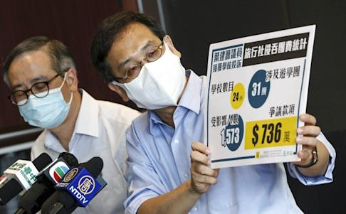 Education lawmaker Ip Kin-yuen raises the study tour refund issue at a press conference. Photo: Jonathan Wong