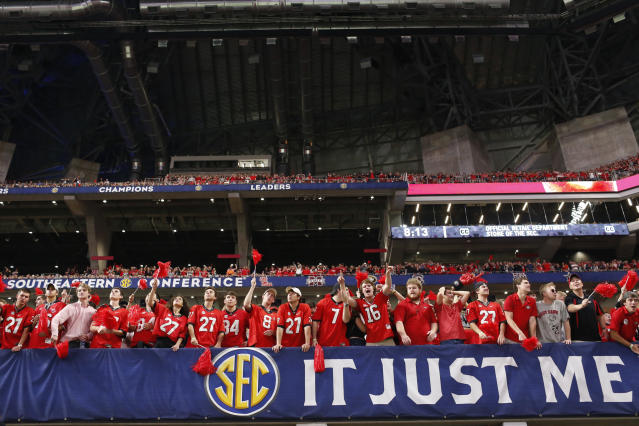 Georgia fans celebrate in the second half of the team's NCAA college football game against Auburn for the Southeastern Conference championship, Saturday, Dec. 2, 2017, in Atlanta. (Joshua L. Jones/Athens Banner-Herald via AP)