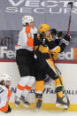 Philadelphia Flyers' Robert Hagg (8) and Pittsburgh Penguins' Brandon Tanev (13) crash against the boards during the third period of an NHL hockey game Thursday, March 4, 2021, in Pittsburgh. (AP Photo/Keith Srakocic)